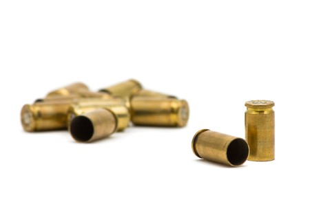 spent: Empty 9mm bullet casings over white background Stock Photo