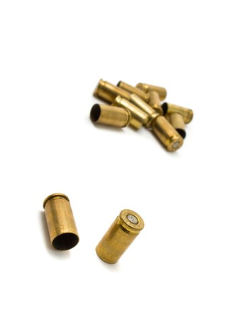 Empty 9mm bullet casings over white background Stock Photo - 7493251