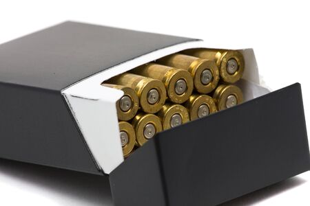 casings: Pack of cigarettes with bullet casings - smoking kills concept