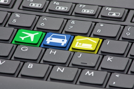 booking: Keyboard with keys to book flight, rental car and hotel - online booking concept
