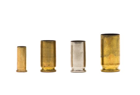 Different sized bullet casings over white background Stock Photo - 7544665
