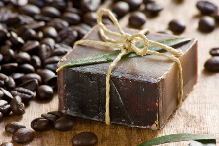Handmade coffee scented soap on wooden background photo