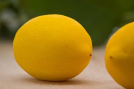 Fresh organic lemons with leaves on wood background Stock Photo - 7575560