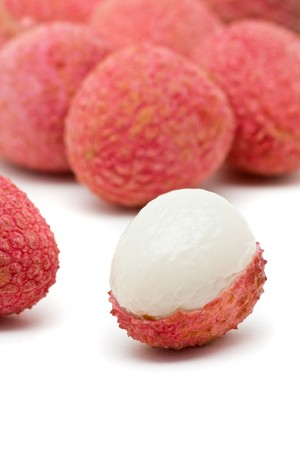 litchee: Delicious juicy red lychees over white background