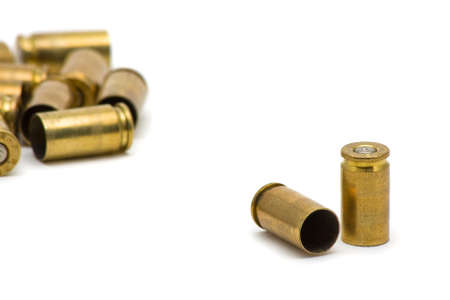 Empty 9mm bullet casings over white background Stock Photo - 7614991