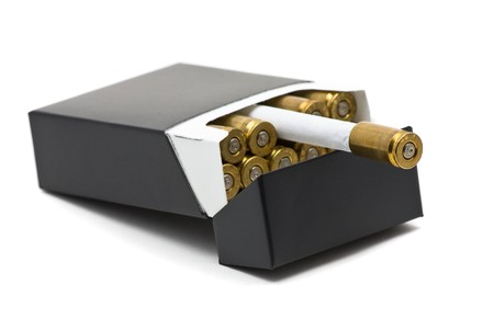 casing: Pack of cigarettes with bullet casing filters - smoking kills concept