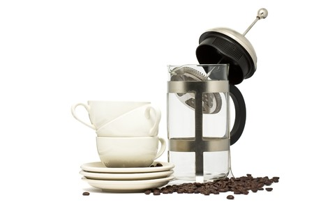 Traditional coffee maker and ceramic cups over white background photo