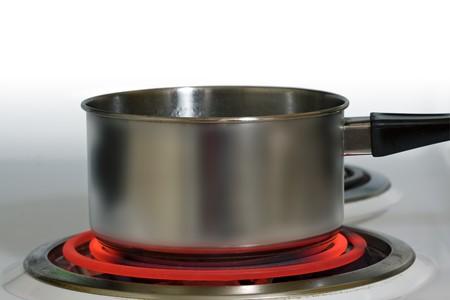 Brushed steel pot on red hot electric stove Reklamní fotografie