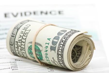 evidence bag: Roll of dollar bills on evidence bag