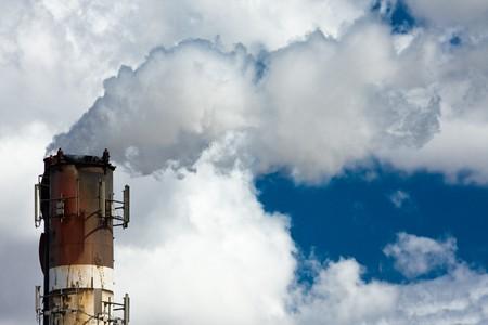 smoke stack: Industrial smoke stack with large white smoke cloud Stock Photo