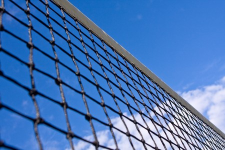 Abstract view of net on tennis court with blue sky and clouds Stock Photo - 7972112