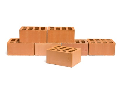 Row of red bricks over white background photo