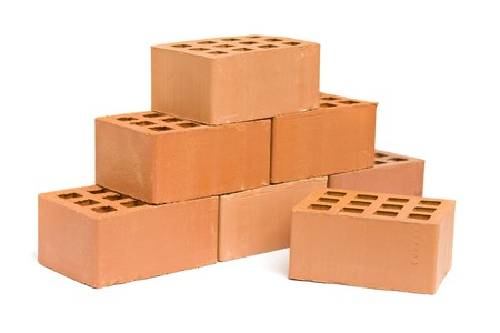 Pyramid of red bricks over white background photo