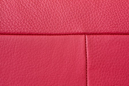 Close up of red leather texture with stitching photo