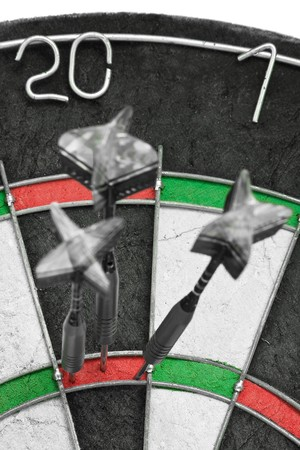Three darts hitting perfect 180 score on dart board Stock Photo - 7972127