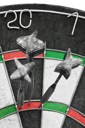 Three darts hitting perfect 180 score on dart board Stock Photo - 7972127