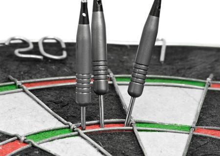 Three darts hitting perfect 180 score on dart board Stock Photo - 7972119