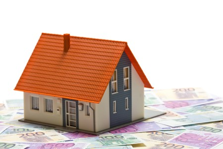 House with money over white background - mortgaging concept Stock Photo - 7972135