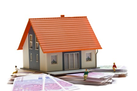 House with money over white background - mortgaging concept Stock Photo - 7972140