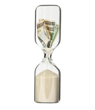 time deficit: Dollar bill in hour glass - recession or financial loss concept