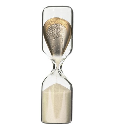 time deficit: Euro coin in hour glass - recession or financial loss concept Stock Photo