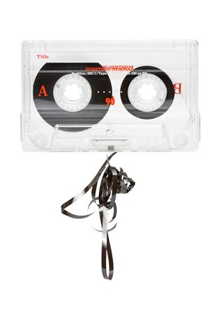 Transparent audio cassette with pulled out tape over white background photo