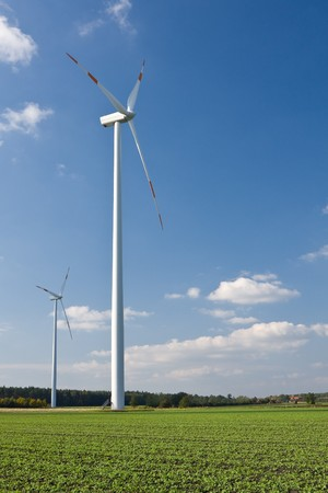 Wind mill in green field with clouds - renewable energy source concept Stock Photo - 8031210