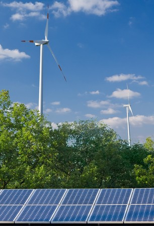 alternative energy sources: Solar panel and wind mill in front of blue sky - alternative energy sources concept