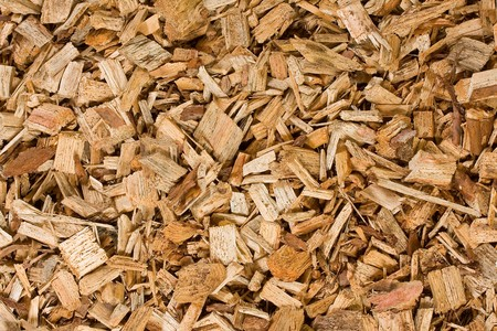 wood heating: Stacked wood chips for wood chips heating systems Stock Photo