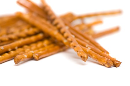 pretzel stick: Salted bread stick snack with selective depth of field over white background Stock Photo
