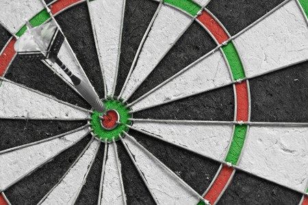 Single dart in the bulls eye on a dart board Stock Photo - 8098257