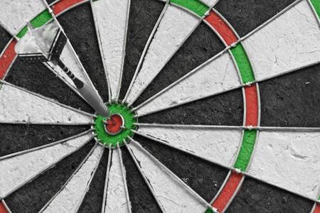 Single dart in the bulls eye on a dart board Stock Photo - 8098257