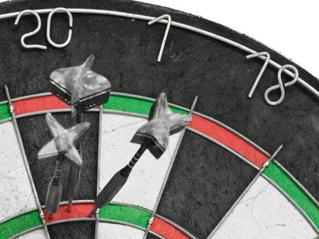 Three darts hitting perfect score on dart board Stock Photo - 8098255