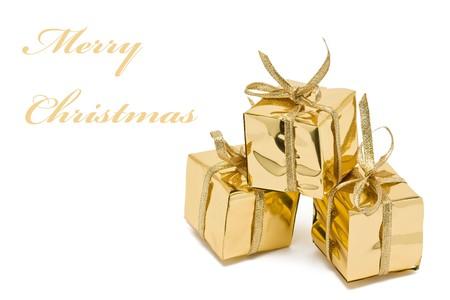 paper packing: Navidad tres presenta oro envuelto en papel de embalaje  Foto de archivo