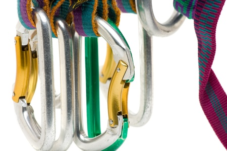 Assorted climbing gear close up over white background Stock Photo - 8278697