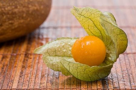 Fresh organic physalis fruit on bamboo background Stock Photo - 8345475