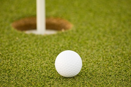 Golf ball on green with copy space photo