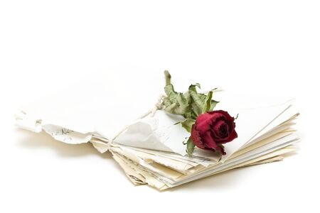 Vintage love letters with red rose over white background photo