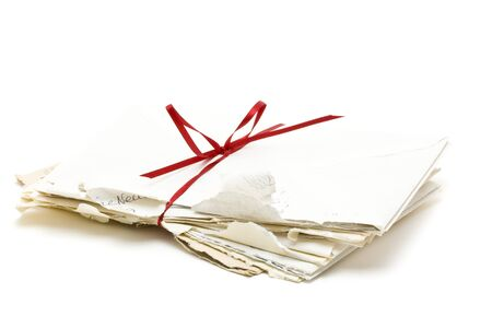 Stack of vintage love letters over white background photo