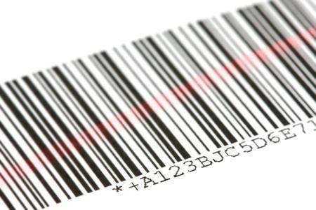 vend: Digital bar code scanned by laser over white background
