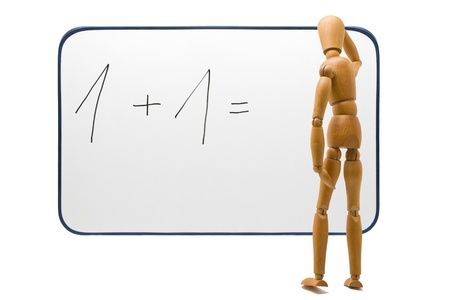 hard to find: Wooden figure tries hard to find solution for complex problem Stock Photo