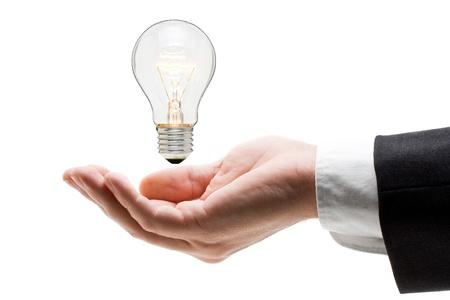 ideas brillantes: Hombre de negocios, sosteniendo la bombilla en su mano - concepto de creatividad