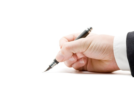 people holding sign: Close up of business mans hand signing paperwork with fountain pen