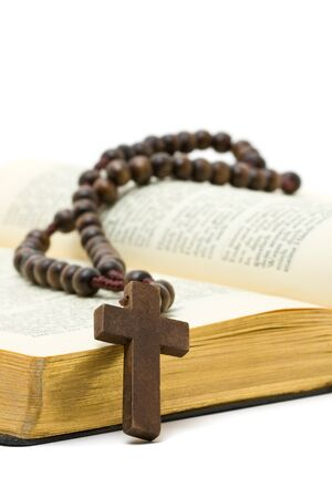 rosary beads: Rosary with holy bible over white background Stock Photo