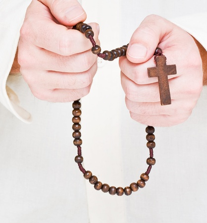 Close up of male hands praying with rosary Stock Photo - 8747267
