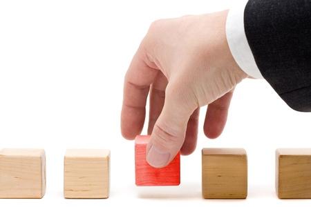 final: Business man putting the final piece into place - achievement concept Stock Photo