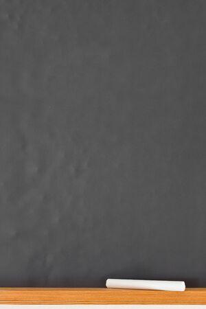 Empty black chalkboard with piece of chalk Stock Photo - 8879526