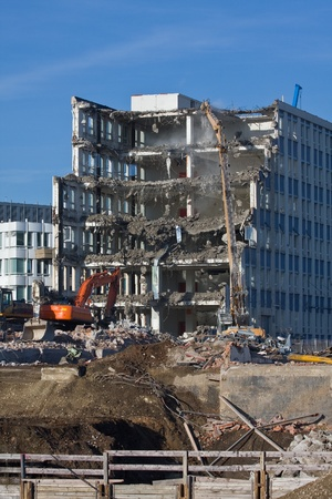 home destruction: Demolition of a building at construction site
