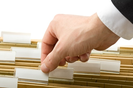 Businessman reaching for office folder in drawer Stock Photo - 8994685