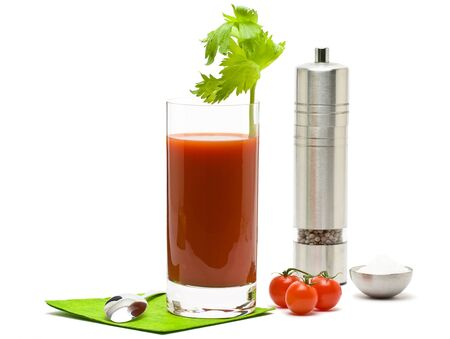 Bloody mary - mix drink from vodka and tomato juice with salt and pepper on white background photo